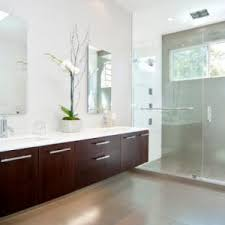 bathroom warm lighting the richness of this cream colored