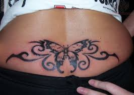 tribal cat tattoo on lower back for girls in 2017 real photo