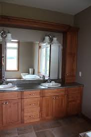 master ensuite with his and hers storage tower and sinks maple
