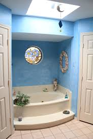 in bath or shower renovation managing water is critical tribune dear tim we are about to remodel our master bath and we re wonder what to do with the round stained glass window over the current tub