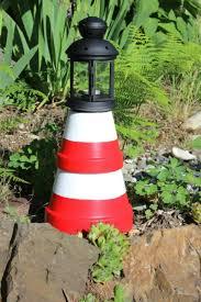 charming diy terra cotta lighthouses garden club