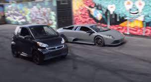 lamborghini smart car rwd lamborghini murcielago drag races electric smart car in