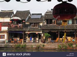 Two Story Houses by Traditional Two Story Houses Along The River Xitang Jiaxing