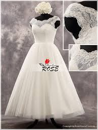 ivory tea length cap sleeves sweetheart neckline lace bodice tulle