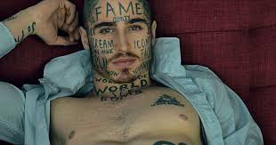 model has words tattooed all his in bid for