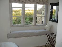 greenish gray bay window ideas living room greenish grey wallpaint white and