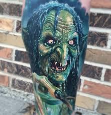 36 ghoulishly grandeur halloween tattoo ideas to rock the look
