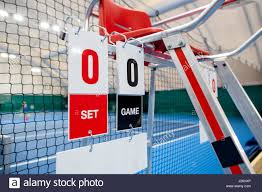 umpire chair with scoreboard on a tennis court before the game