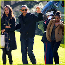 president obama family arrive home from vacation