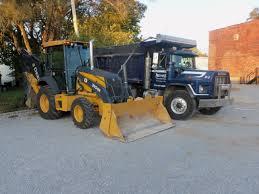 mack dump truck yellow john deere 310sk backhoe u0026 blue tri axle mack model rb dump