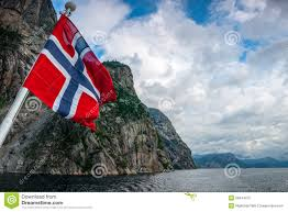 norwegian flag against fjord mountains stock photography image