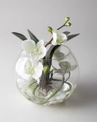 Faux Floral Centerpieces by Love The Arrangement Of This Orchid Centerpiece Like The Green