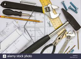 construction tools and blueprints for a new house project stock