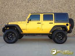 yellow jeep wrangler unlimited jeep wrangler with 20in fuel krank wheels flickr photo sharing