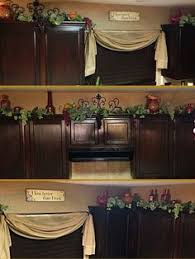 Top Of Kitchen Cabinet Decorating Ideas by Decorating Above Kitchen Cabinets Tuscany Here U0027s A Closer Look