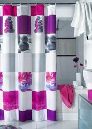 white shower curtain with black flower accents in modern bathroom
