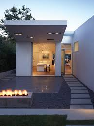 White Color Small Summer House Design With Pathway Concrete Pavers - Minimalist home design