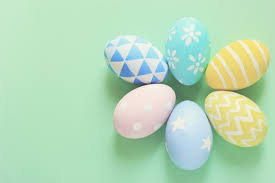 pastel easter eggs pastel and colorful easter eggs with copy space on green