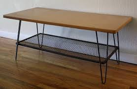 wooden coffee table with metal hairpin legs and wire shelf as well
