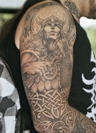 grey ink celtic and viking on right arm http bit ly