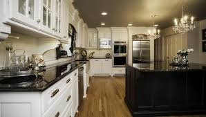 kitchens with two different colored cabinets white upper cabinets