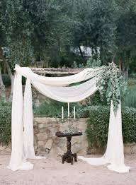 wedding arches using tulle how to decorate a wedding arch with fabric 9711