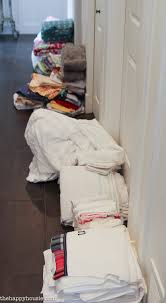 how to completely organize your linen closet the happy housie start by sorting everything into piles of related items for example i sorted our bathroom linens into large towels hand towels facecloths and bathmats