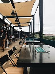 Restaurant Patio Planters by Hang On Lounge Swings At This New San Diego Brewery
