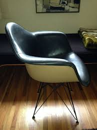 eames fiberglass shell chairs with painted backs or two tone shell