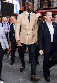 lebron james wearing tan double breasted blazer white dress shirt