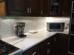 groutless brick mother of pearl shell tile kitchen backsplash