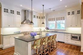 kitchen island with 4 stools kitchen island with rubbed bronze mini pendants transitional