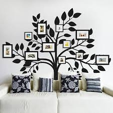 17 family photo wall ideas you can try to apply in your home living room family photo wall collage design combined with black tree wall decals on white wall