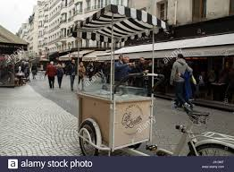 Striped Canopy by One Of The Classic Food Carts In Paris With The Black And White