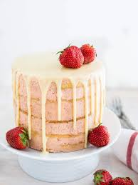 strawberry layer cake with white chocolate ganache drip