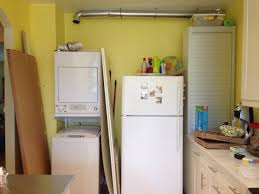 Kitchen High Cabinet Hackers Help Hiding Stackable Top Load Washer Dryer In Akurum