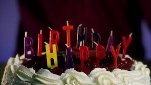 burning candles on a birthday cake stock footage video 2505428