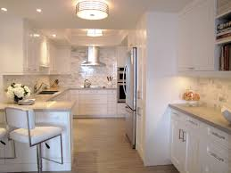 shitake countertops and marbled backsplash give this elegant white