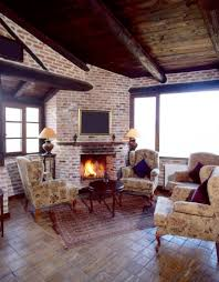 25 sublime rustic living room design ideas this simple rustic living room uses some matching antique chairs and an interesting tiled wood