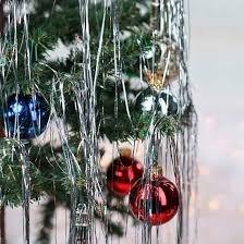 christmas tree tinsel retro inspired silver metallic tinsel strands christmas garlands