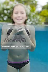 preteen girl modeling portrait of a girl neck deep in water stock photo masterfile