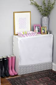 interior girly entryway design with white table feat decorations