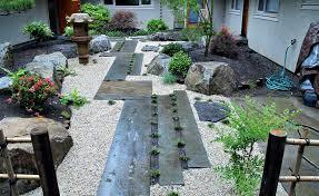 japanese zen garden design with natural stone walkway and corner