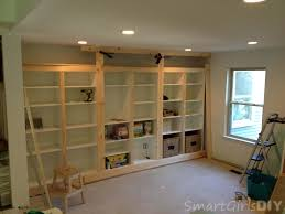 diy built in bookshelves using ikea besta family room 8