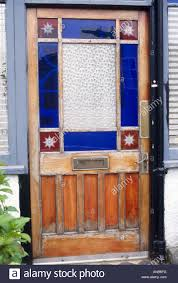 stained glass door windows close up of front door with blue and red victorian stained glass