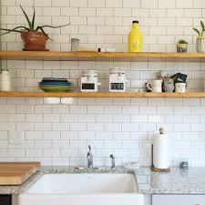 kitchen shelf arrangement painted brick walls floating kitchen