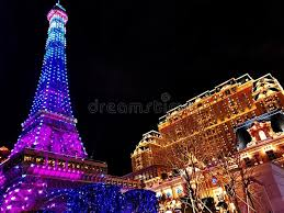 eiffel tower christmas lights the parisian hotel and eiffel tower in the night editorial image
