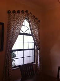 arched window treatment with geometric curtain and rounded half
