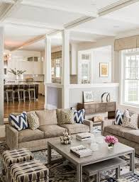 open concept living room apartment white window curtains brown