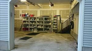 garage storage and floor examples neat storage designs new jersey garage remodel before polyurea floor and monkey bars storage system installed by neat storage designs